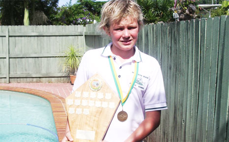 Tristan is pictured at home with his latest trophy.