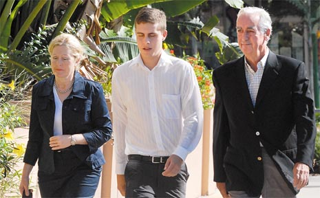 De-Anne, Ian and Roger Kelly walk together into the Mackay Courthouse.