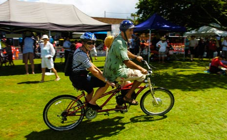 Greens MP Ian Cohen gives Jan Barnham a ride on his tandem electric bicycle.