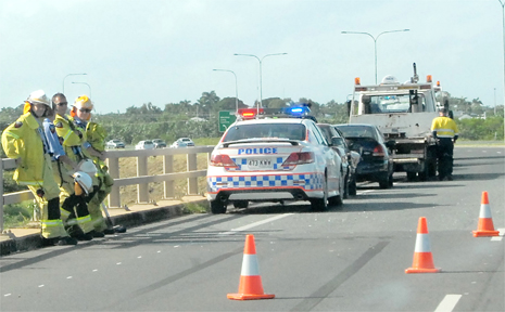 A four-vehicle, bumper-to-bumper accident delayed peak-hour traffic on the Ron Camm Bridge yesterday.