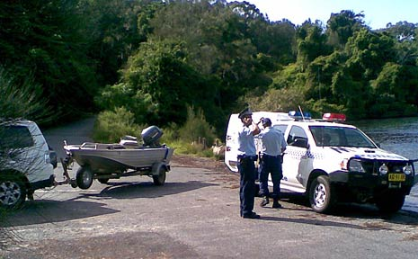 Police at Bonville Creek after a fisherman was washed off rocks and drowned.