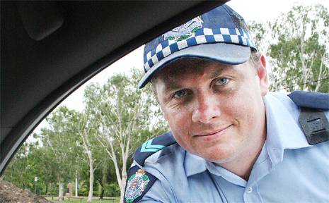 Former police officer Benjamin Price, seen here on traffic duty, is facing six counts of assault occasioning bodily harm on three separate occasions while working as a police officer in the Whitsundays.