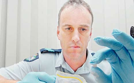 Sergeant Nigel Dalton with suspected MDMA seized by police in Mackay last month.
