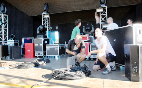 River Sessions 'roadies' are at front on the phone Josh Maher, at back in green Justin Garwood, in front Adrian Young and back Drew Carden help set up for today's festival.