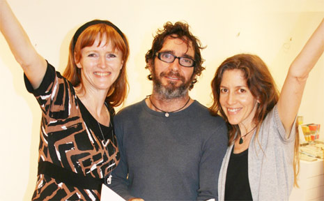 Illustrator and artist Michelle Dawson, publisher Simon Greaves and singer and author Gyan with the book that has been shortlisted for a prestigious award.