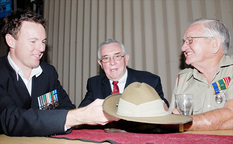 East Timor and Afghanistan veteran Kerrin Connolly, left, Malaya and Vietnam veteran and Mackay RSL sub-branch president Barrie Stark and 9 Field Ambulance Army Reserve's Rob Amos get together to discuss Anzac Day plans.