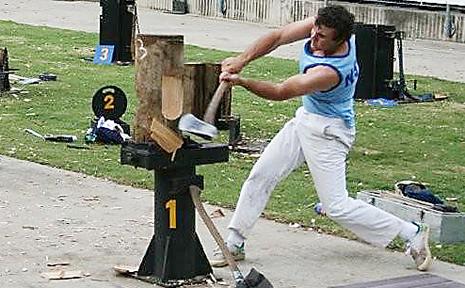 GRAFTON axeman Matt Owen wielding a furious axe at the Sydney Royal Easter Show.