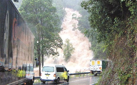 Waterfull Way ... reader Diane Bailey sent us this amazing image driving down from Dorrigo to Bellingen taken on the day of the big flood.
