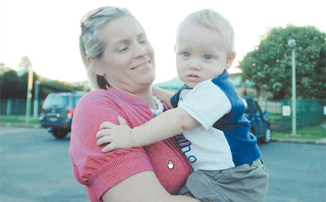 Terri Joy, of Grafton, picks up her son Kobey, 14 months, from daycare.