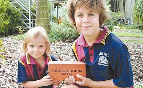 Coningsby State School students Mason Kohler and Roby Robinson display a sample of the bricks that will be used to build a wall to commemorate 125 years of education. Past and present families will be able to purchase a brick and have their name on it.
