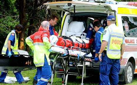 A man is put into a waiting ambulance after a single vehicle accident on Coolamon Scenic Drive near Mullumbimby Golf Course yesterday.