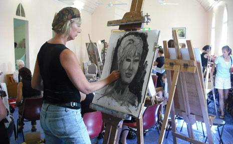 Shobhan Oliver starts her portrait of Di Morrissey at the FEHVA 2009 portrait sitting last Saturday.