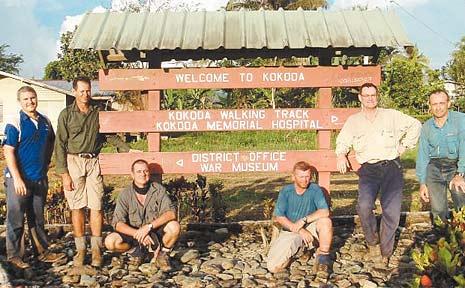 Taking a break at Kokoda after walking the Kokoda Track are (from left) Jamey Strohfeldt, Stephen Oberg, Gaven Klingner, Jason Horton, Bruce Haines and Lt Col Frank Marchetti.