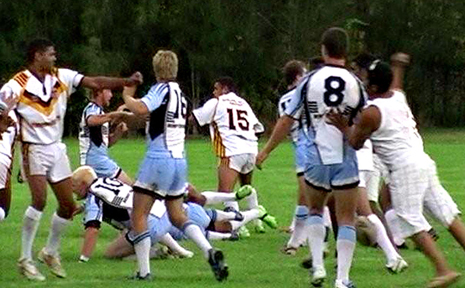 OUT OF CONTROL...This picture shows an unsuspecting Woolgoolga prop Neil Baker (number eight) about to be attacked from behind during Sunday's controversial Group 2 clash at Woolgoolga Sportsground.