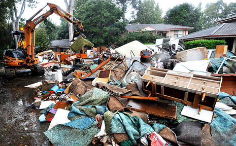 What a mess...domestic flood rubbish waiting to be picked up at the Gundagai Street unit.