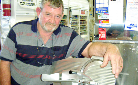 Warren Ellem, 58, fought off a knife-wielding robber by throwing a meat slicer at him.