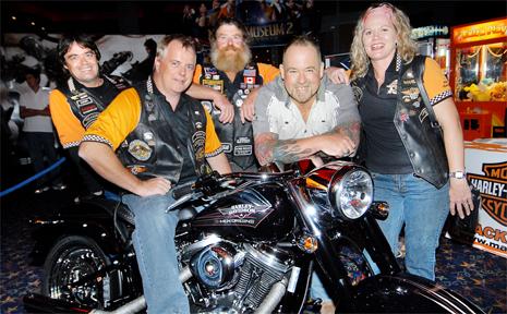 Mark Broadstock, left, Roger Martin, Les Pratt and Ross Kiley of Mackay Motorcycles, and Marlene Rashleigh, were among Harley-Davidson riders at last night's screening of the new Wolverine movie.