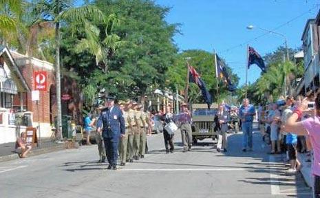 The parade makes its way down Bangalow's main street.