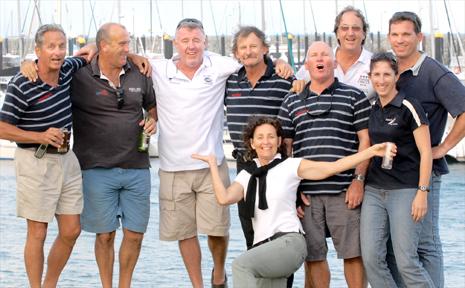 The victorious crew of Re-Ignition, from left, Bob Thomas, Ed Psaltis, Greg Tobin, Seddon Cripps, Joslyn Gervais, Allan Ravell, Bert Salisbury, Myra and Steve Robertson.