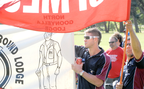 CFMEU members Hayden Buchanan and Mark Sanim, of Mackay, show their support at Mackay's Labour Day rally yesterday.