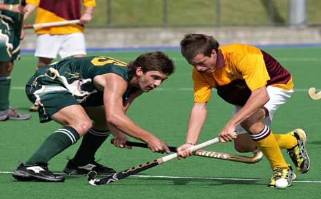 An Ipswich player (left) duels with Tweed opponent Dylan Wotherspoon during the Division 2 final at the state under-18 hockey titles.