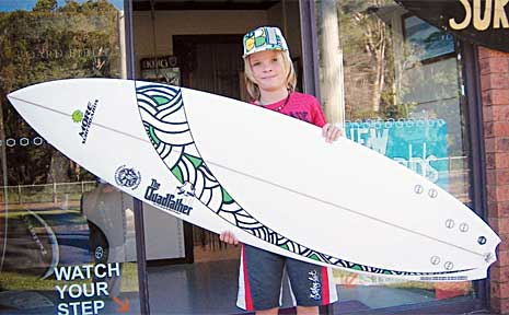 Angourie board shaper Mark Pridmore shaped a new board for ex-world champion Tom Carroll, while Mark's son, Cain (pictured) produced the artwork.