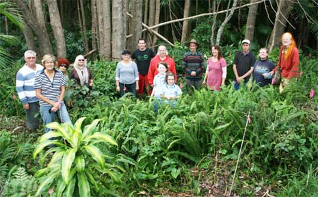 Residents and BEC volunteers at the site where plants were stolen.
