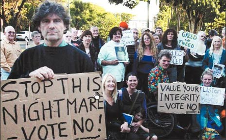 Caldera Residents Action Group president John Donvito and protesters outside Tweed Shire Council chambers yesterday.