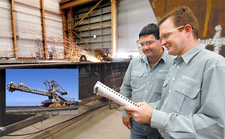 G&S; Engineering Services works manager Geoff Holder, left, with chief operating officer Mick Crowe in the fabrication shed where the company is working on a counter weight boom as part of stacker reclaimers for Abbot Point Coal Terminal.
