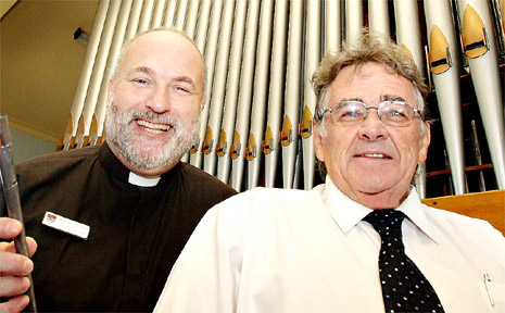 Father Colin Tett and music director Ross Johnson with the grand old organ at Murwillumbah Anglican Church.