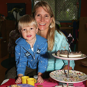 Jack Munro treats mum Lisa to high tea at the Coolum Kindy's mothers pamper morning. Photo: Mike Garry/scw1504c