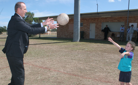 PLAY BALL: Senator Joe Ludwig Minister for Human Services catches a netball from young Biloela netballer Anna Smith at the annoucement of $2.3 million towards the expansion of the Magavalis Sports Complex.