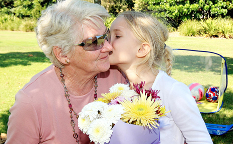 Grandma Thelma Terry gets extra mother's day kisses and flowers from Grandaughter Taiya Healy in the park in Casurina.