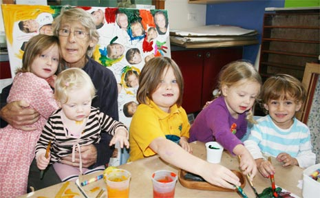 Artist Peter Powditch is pictured at the children's centre with grandchildren and budding artists Maggie Hall, Maisie Hall, Mabel Hall, Mary Hall and Ned O'Neill.