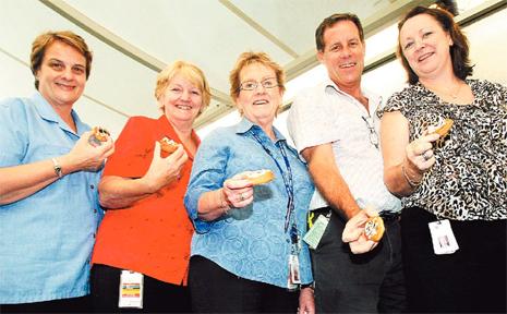 Tweed nurses Robin Fox, Margaret Balli, Leone Hartley, Brian Everson and Denise Harris enjoy morning tea on International Nurses Day yesterday.