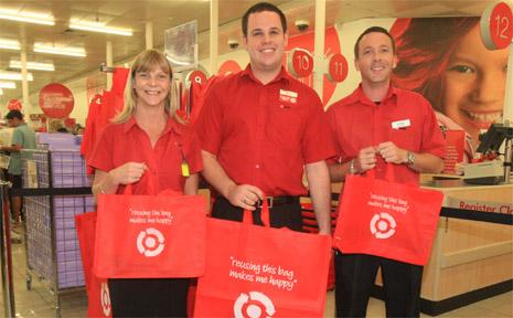 Centro Tweed Target's Camilla Sedgman, Matt Garner and Steve Barnes with the store's reusable shopping bags.