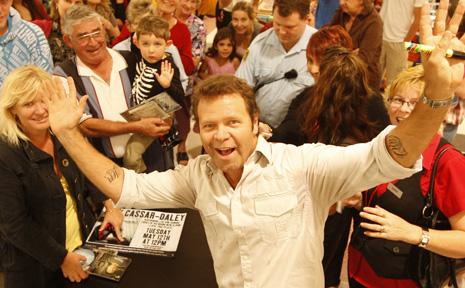 COUNTRY singer Troy Cassar-Daley had them dancing and calling for more when he held a free concert in Grafton's Shoppingworld yesterday.