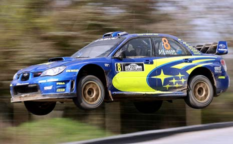 Chris Atkinson flies his Subaru Impreza WRC racer at the 2007 Rally New Zealand