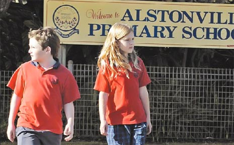 STAY SAFE: Alstonville Primary School Year 6 students Sean McCarthy, 10, and Elke Howell, 11, check both ways as they practise walking to school safely.