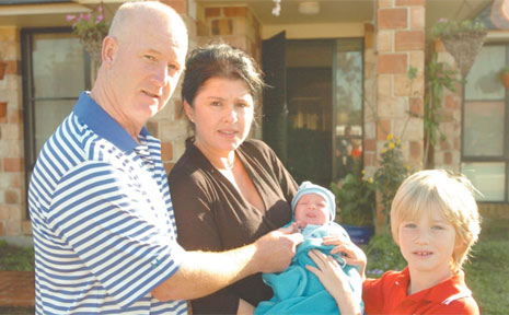 NOT IN OUR BACKYARD: Dr David Richards, of Iluka, with wife Janelle, baby Phoenix and eight-year-old Jarrod. Mr and Mrs Richards successfully protested against plans for an Optus mobile phone tower in Henry Searle Drive.