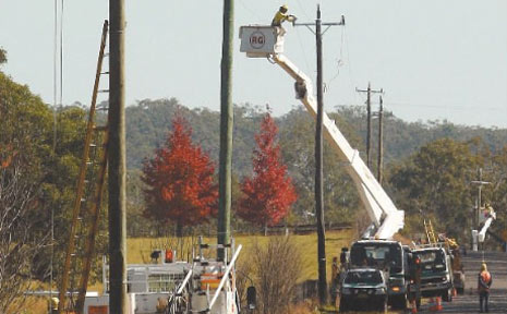 POWER AID: Country Energy workers upgrade power along Clarence Way as part of a Copmanhurst area upgrade.