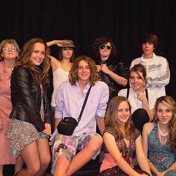 The cast of Skooliez prepare for next week's opening.