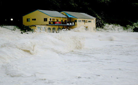 Coastal areas are taking a battering from the severe weather plaguing southeast Queensland and northern NSW. Pictured is the Yamba Surf Life Saving Club clubhouse being battered by the surf.