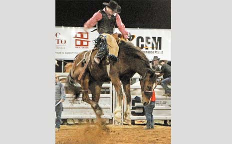Allan Powell holds on aboard Eastern Creek at the Nebo rodeo.