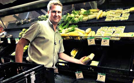 Park Avenue Woolworths acting trading manager Grant Hofman helps with the mammoth job of restocking shelves.