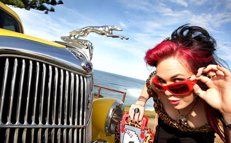 Vanessa Collins, from That Shop in Coolangatta, gets into the Wintersun theme at Point Danger with a 1935 Ford Sedan.