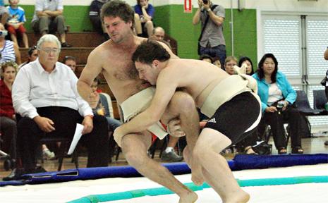 Dwayne Lewis of Chinderah and Blake Stacey  of Tweed in sumo action.