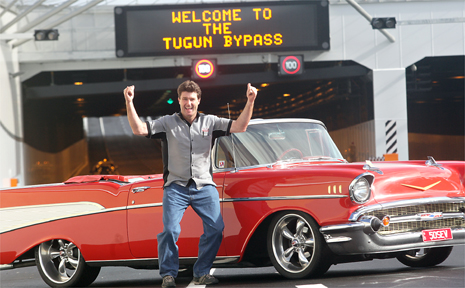 Greg Leahy jumps for joy at the opening last year of the Tugun bypass.