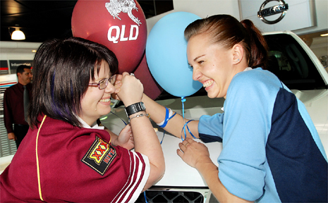 It was work mate against work mate at North Jacklin Motors for parts clerk Justine Overend and services adviser Tasha Dunlop in the lead-up to the first State of Origin clash last night.