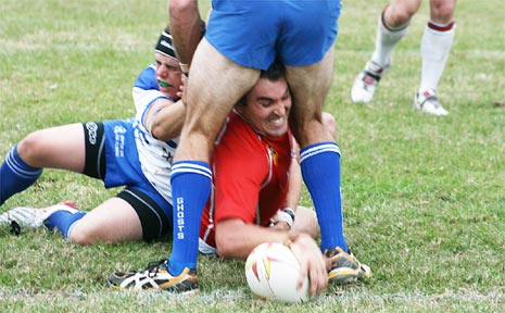 Dallas Hood squeezes through for a Red Devils try.